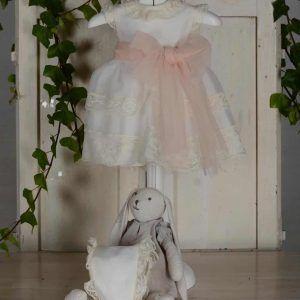 Vestido con lazo rosa de bautizo